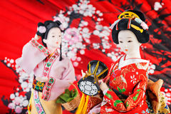 Japanese Doll. S on red background royalty free stock photos