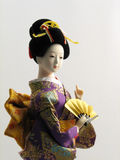 Japanese Doll with Fan Royalty Free Stock Image