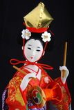 Japanese Doll in kimono half portrait Royalty Free Stock Photography