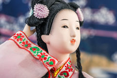 Japanese Doll. In pink kimono close-up royalty free stock photos