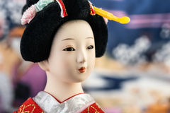 Japanese Doll. In red kimono close-up stock photos