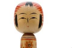 Japanese doll on white background. Japanese Kokeshi doll close-up photograph on white background stock photography