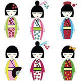 Japanese dolls. Japanese inspired by Asian culture, set of 6 dolls with vary outfits including flowers, hearts, bow, fan , hair accessories Royalty Free Stock Photos