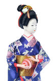 Japanese dolls. Isolated Japanese girl doll in Blue kimono royalty free stock image