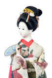 Japanese dolls. Isolated Japanese girl doll in yellow kimono Royalty Free Stock Photography