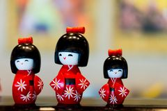 Japanese dolls look cute in a woman& x27;s dress. royalty free stock images