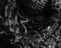 Japanese dragon. Shot in black and white, detail on an sculpture representing a dragon placed on the facade of this buddhist temple, set at Kyoto, Japan, Asia Royalty Free Stock Image