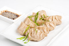 Japanese dumplings with soy Royalty Free Stock Photos