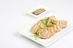 Japanese dumplings with soy. On the plate Royalty Free Stock Images