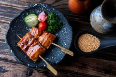 Japanese eel grilled in skewer. Japanese eel grilled in skewer or Unagi ibaraki set on plate in Japanese style with studio lighting stock photos