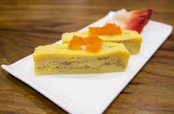 Japanese egg sushi. On white plate stock photo