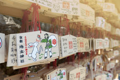 Japanese Ema or small wooden votive plaques hanging up at a shrine Stock Images