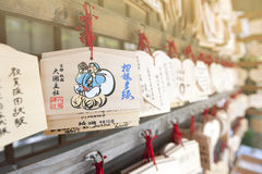 Japanese Ema or small wooden votive plaques hanging up at a shrine Royalty Free Stock Images