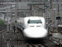Japanese express train. Shinkansen Express Nozomi leaving Kyoto station stock images