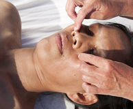 Japanese facial massage Stock Photography