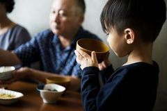 Japanese family dining together with happiness Royalty Free Stock Images
