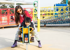 Japanese Family is having fun in Public playground. Stock Images