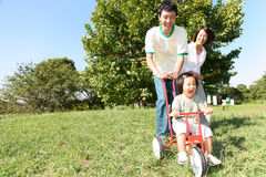 Japanese family playing in the park Stock Photo