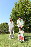Japanese family playing in the park. Concept shot of Japanese people's life style Royalty Free Stock Image