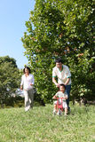 Japanese family playing in the park Royalty Free Stock Photos