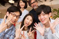 Japanese family taking their photograph at home party Stock Photos