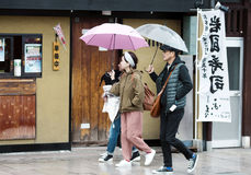 Japanese family on a walk down the street in Iwakuni town Royalty Free Stock Photo