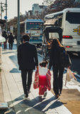 Japanese family walking down the street in Kamakura Royalty Free Stock Images