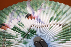 Japanese fan depicting birds in the trees Royalty Free Stock Photo