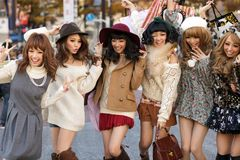 Japanese fashion girls group. A group of girls is posing in the middle of the street for fashion advertising in the street near the Shibuya crossroad in Tokyo royalty free stock image