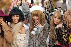 Japanese fashion girls group. A group of girls is posing in the middle of the street for fashion advertising in the street near the Shibuya crossroad in Tokyo royalty free stock images