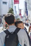Japanese father carrying son Ginza Tokyo. Japanese father carrying son on Chuo-dori street in Ginza area in Tokyo, Japan Stock Photos