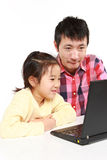 Japanese father and daughter on laptop computer Royalty Free Stock Photos
