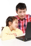 Japanese father and daughter on laptop computer Stock Photo