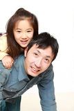 Japanese father and his daughter play horse-ride Stock Photography