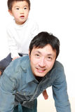 Japanese father and his son play horse-ride Stock Photo