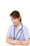 Japanese female doctor depressed Royalty Free Stock Image