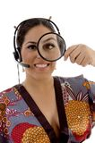 Japanese female looking through magnifying lens Stock Photography
