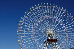 Japanese Ferris Wheel 2:39. Detail shot of a ferris wheel in Yokohama, Japan on a beautiful bright summer day royalty free stock photography