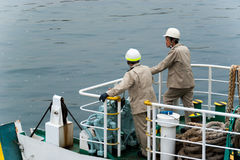 Japanese ferry workers waiting to dock Stock Photo