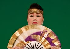 Japanese Festival Dancer with a fan. Kagoshima City, Japan, October 27, 2007. An older Japanese dancer in kimono perform with a fan onstage in the night portion stock image