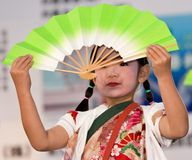 Japanese Festival dancer with a fan. Kagoshima City, Japan, May 5, 2007. Dancer in yukata kimono performing onstage with a paper fan in the Daihanya Festival stock image