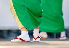 Japanese Festival dancer's feet. The feet of dancers in yukata kimono ans wearing tabi shoes as they performsonstage stock photo