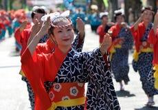 Japanese Festival Dancers. Kagoshima City, Japan, October 28, 2007. Women in yukata kimono dancing in symmetry during the Taniyama Furusato Matsuri dance royalty free stock images