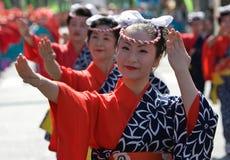 Japanese Festival Dancers. Kagoshima City, Japan, October 28, 2007. Women in yukata kimono dancing in symmetry during the Taniyama Furusato Matsuri dance royalty free stock photo