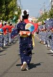 Japanese Festival Dancers. Kagoshima City, Japan, October 28, 2007. The backs of women in yukata kimono dancing in symmetry during the Taniyama Furusato Matsuri royalty free stock photo