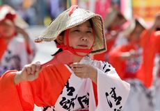 Japanese Festival Dancers. Kagoshima City, Japan, October 28, 2007. A women wearing a straw hat and a white and red yukata dancing during the Taniyama Furusato stock image