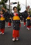Japanese Festival Dancers. Kagoshima City, Japan, October 28, 2007. Young girls in yukata kimono dancing in symmetry during the Taniyama Furusato Matsuri dance royalty free stock photos