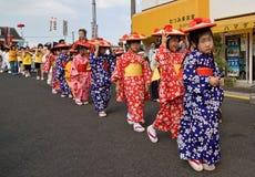 Japanese Festival Dancers. Kagoshima City, Japan, October 28, 2007. Young girls in yukata kimono and straw hats preparing to dance during the Taniyama Furusato royalty free stock images