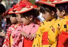 Japanese Festival Dancers. Kagoshima City, Japan, October 28, 2007. Young girls in yukata kimono and straw hats preparing to dance during the Taniyama Furusato stock images
