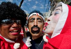 Japanese Festival Dancers. Kagoshima City, Japan, October 28, 2007. Three Japanese men in makeup and comical costumes pose for the camera during the Taniyama stock images